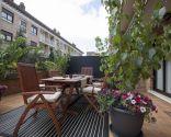 Terraza veraniega, confortable y divertida