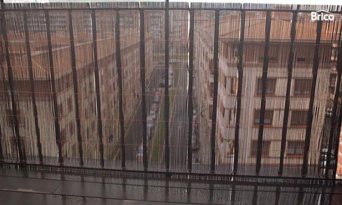 Colocar malla de ocultaci n en balc n for Tapar barandilla balcon