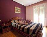 Decorar un dormitorio femenino y luminoso