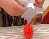 Boina con pompones