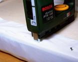 Cómo tapizar la tapa de un baúl paso 9
