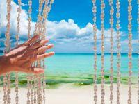 Cortinas y carillones de viento con conchas de mar