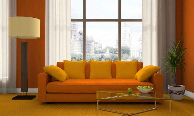 Combinar un sof naranja en un sal n hogarmania for Combinar colores decoracion salon