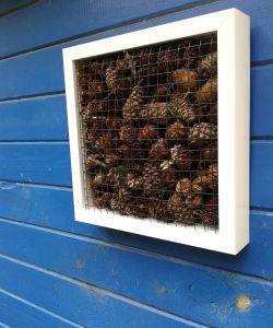 Hoteles de insectos en cuadros