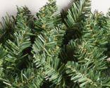 corona navideña con ramas