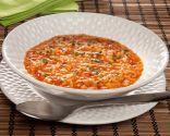 Lentejas picantes con arroz y queso fundido