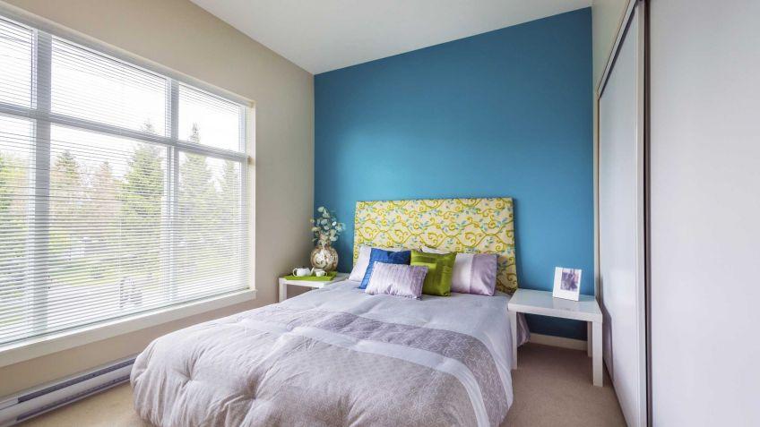 Decoración frontal de cama en azul y verde pistacho - Hogarmania
