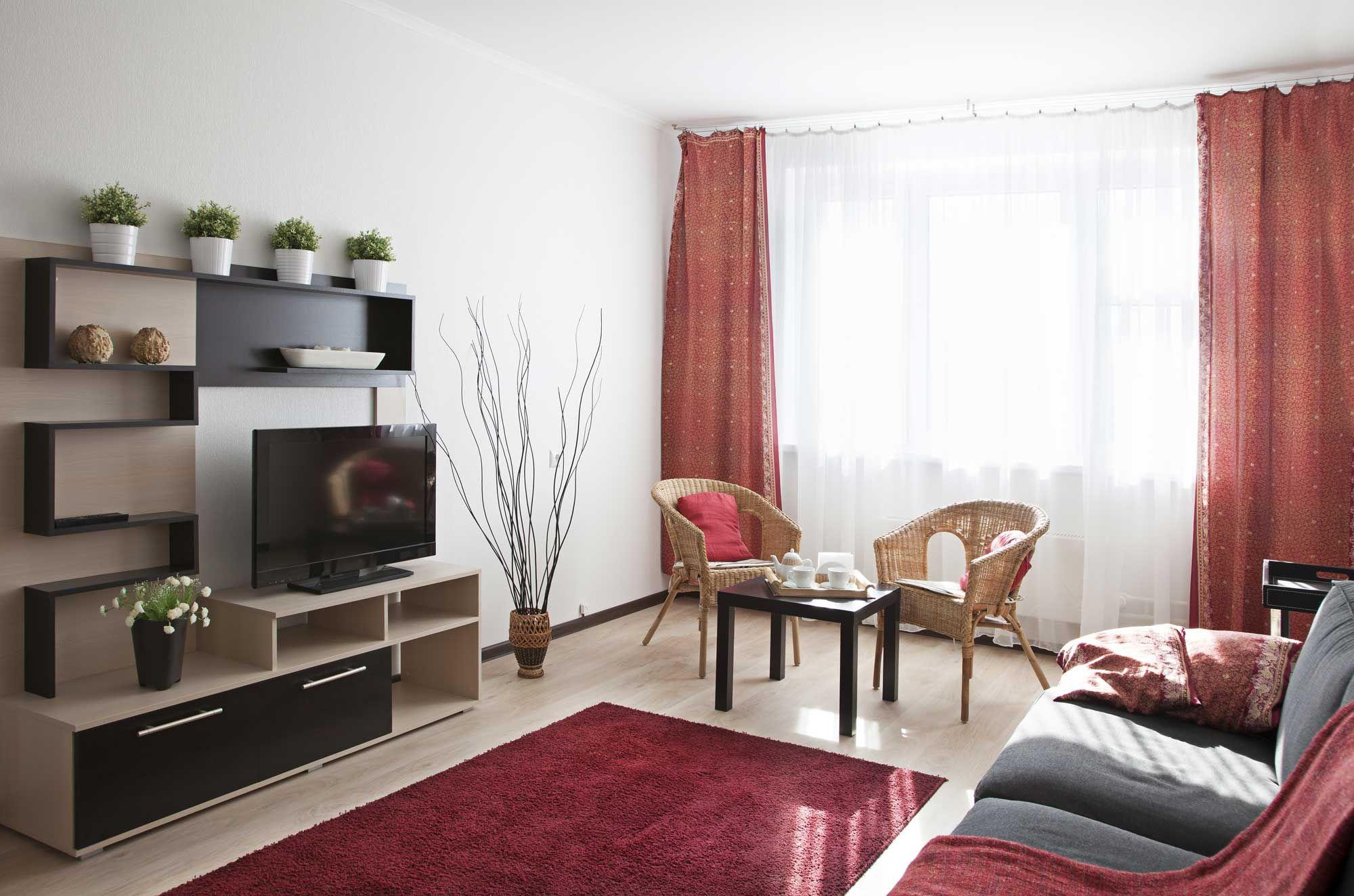 Sala de color rojo gris y beige hogarmania for Muebles rojos para sala