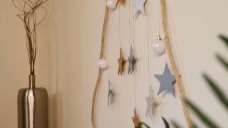 Árbol navideño de pared con estrellas