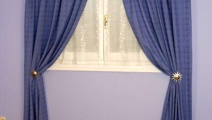 Hacer un cabecero con una barra de cortina bricoman a for Como poner ganchos cortinas