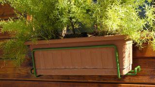 Arreglar el soporte de la jardinera