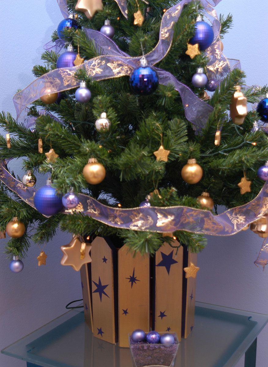 Ideas para decorar el pie del rbol de navidad hogarmania - Ideas para decorar estrellas de navidad ...