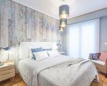 Dormitorio cálido y acogedor en azul y gris