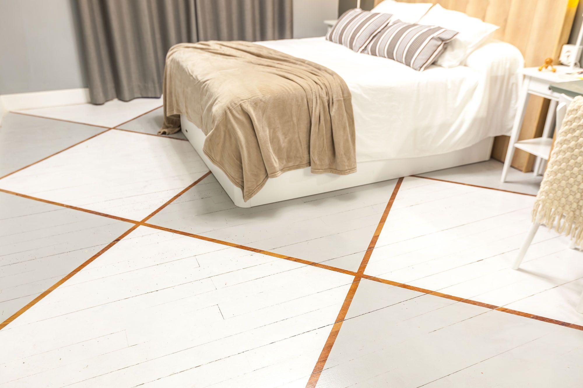 suelo del dormitorio con mini estudio nórdico