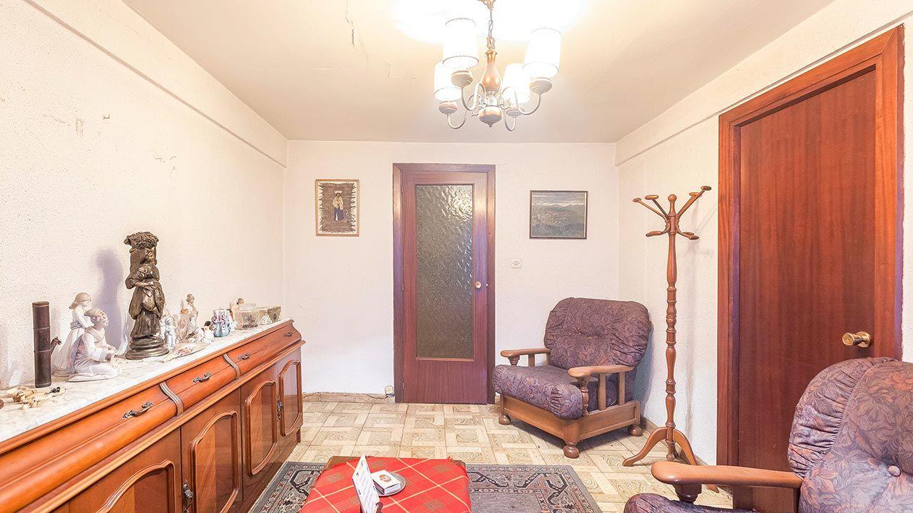 Transformar una sala antigua en una habitación individual