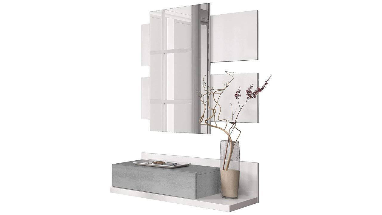 Un mueble recibidor gris con espejo