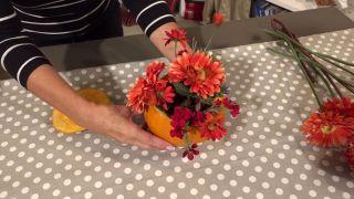 2 centros florales con calabaza