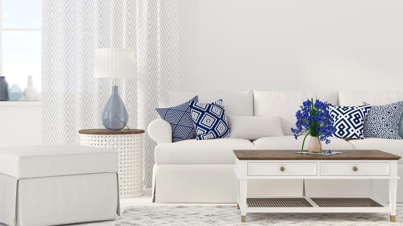 Cojines con estampados geométricos para decorar el sofá