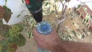 Sistema de riego casero con botella de plástico y cono de arcilla