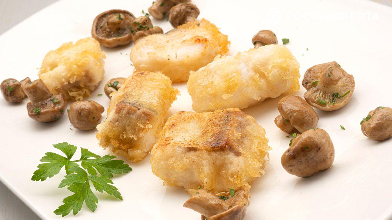 Merluza en tempura con setas de primavera