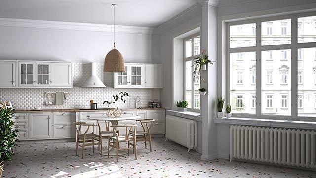 Suelo de terrazzo moderno en cocina blanca